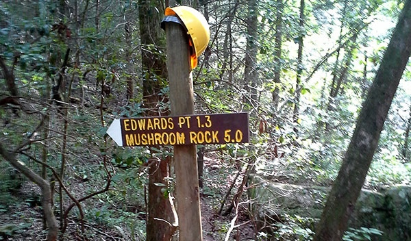 Hard-hat-on-trail-sign-cropped